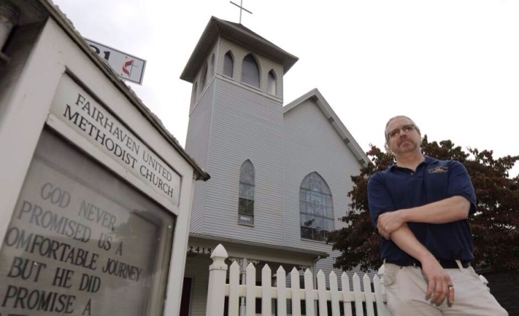 Historian Rich Cummings stands outside the Fairhaven United Methodist Church in Overbrook near the intersection of Routes 51 and 88, Thursday, October 3, 2013. The city recently awarded the church historical landmark status.